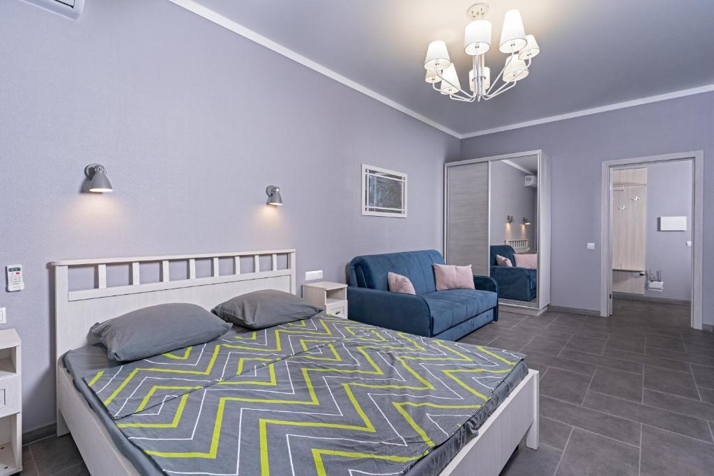 A bed or beds in a room at Premium апартаменты на первой береговой линии
