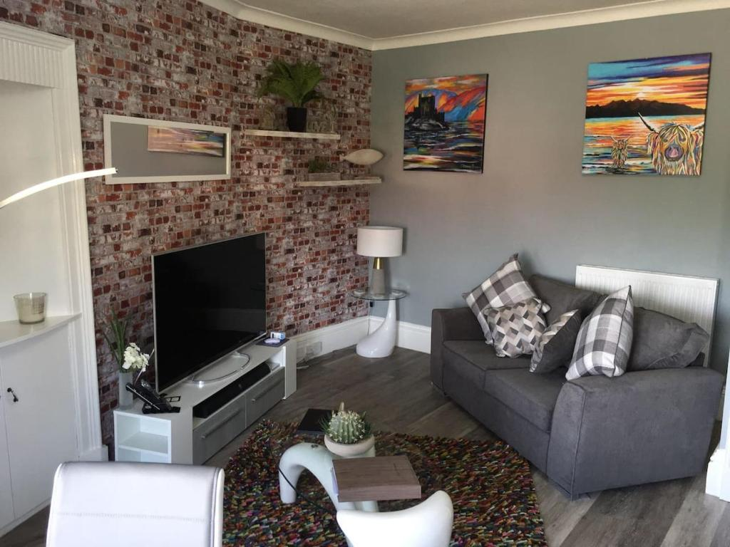 A seating area at Stunning 2-Bed Apartment in Hawick