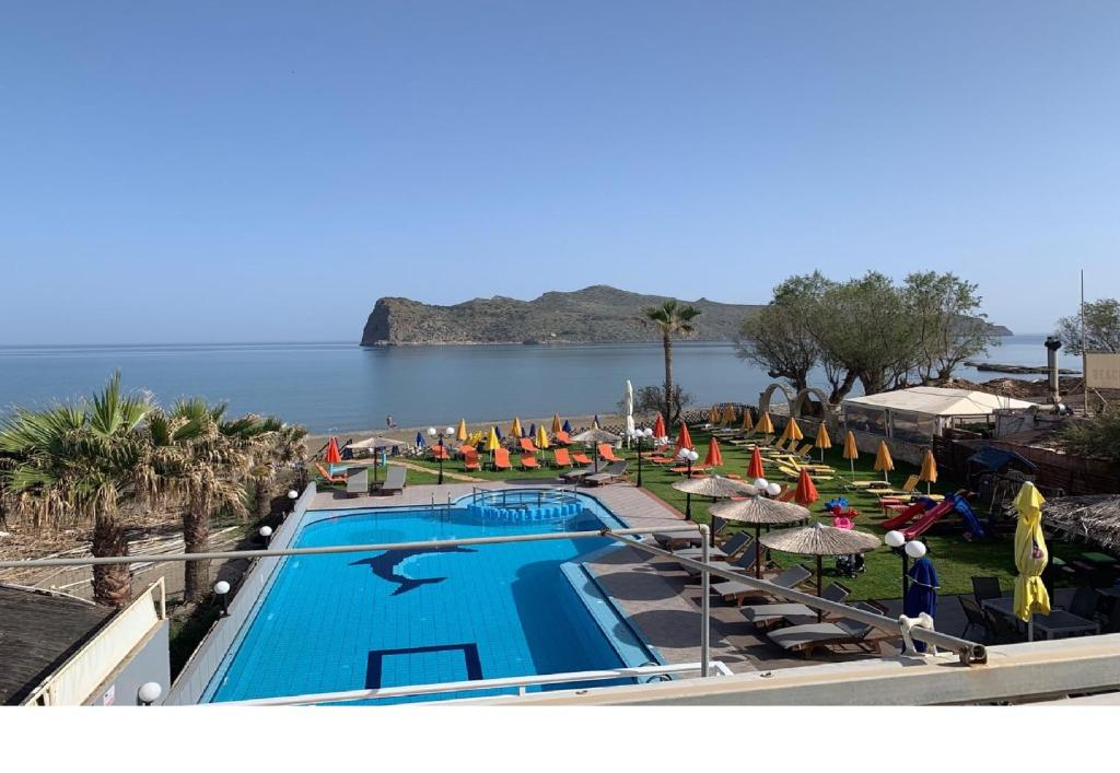 A view of the pool at Coral Beach Hotel or nearby