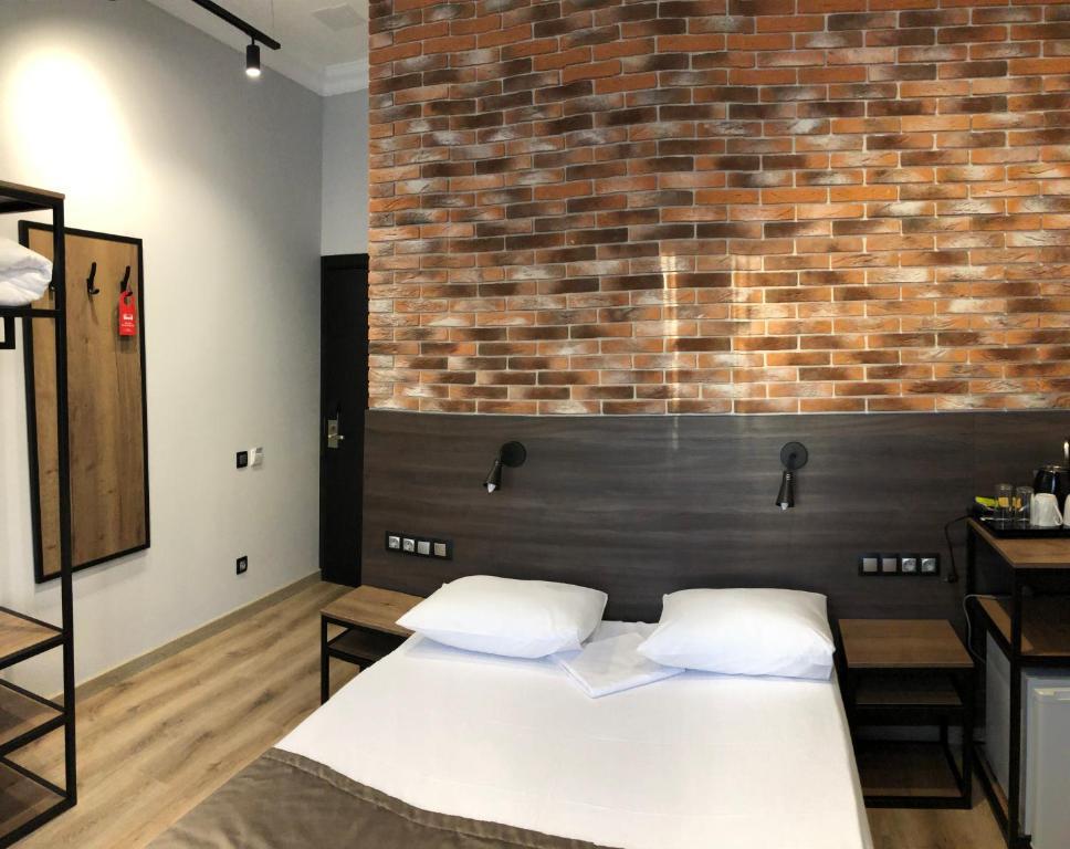 Кровать или кровати в номере Xenia City Hotel Zelenograd