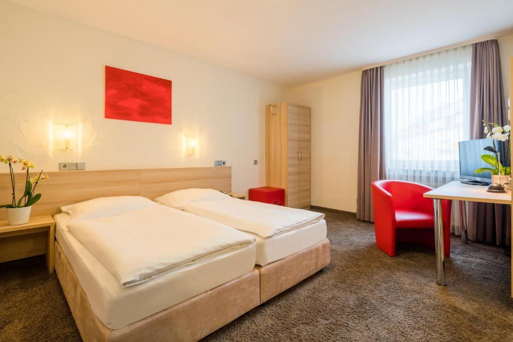 Ein Bett oder Betten in einem Zimmer der Unterkunft Hotel Wanner