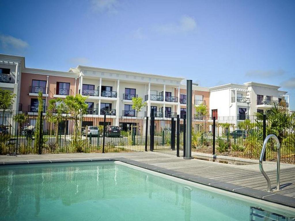 The swimming pool at or near Apartment Adonis La Baule-1