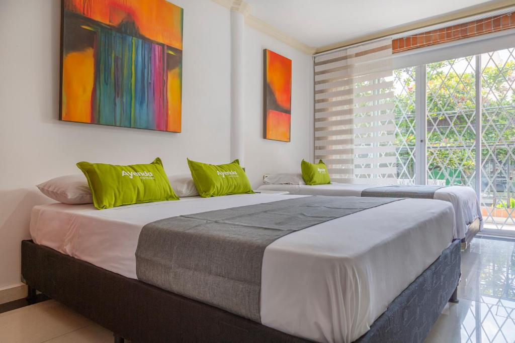 A bed or beds in a room at Ayenda 1258 Boutique Laureles Home