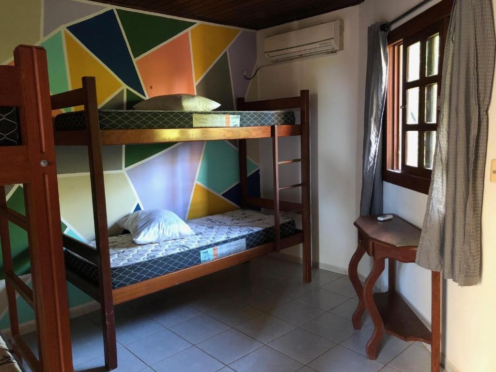 Uma ou mais camas em beliche em um quarto em Galeria Hostel