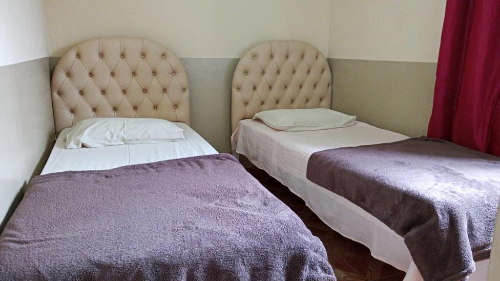A bed or beds in a room at Vitória Center Plaza Praça