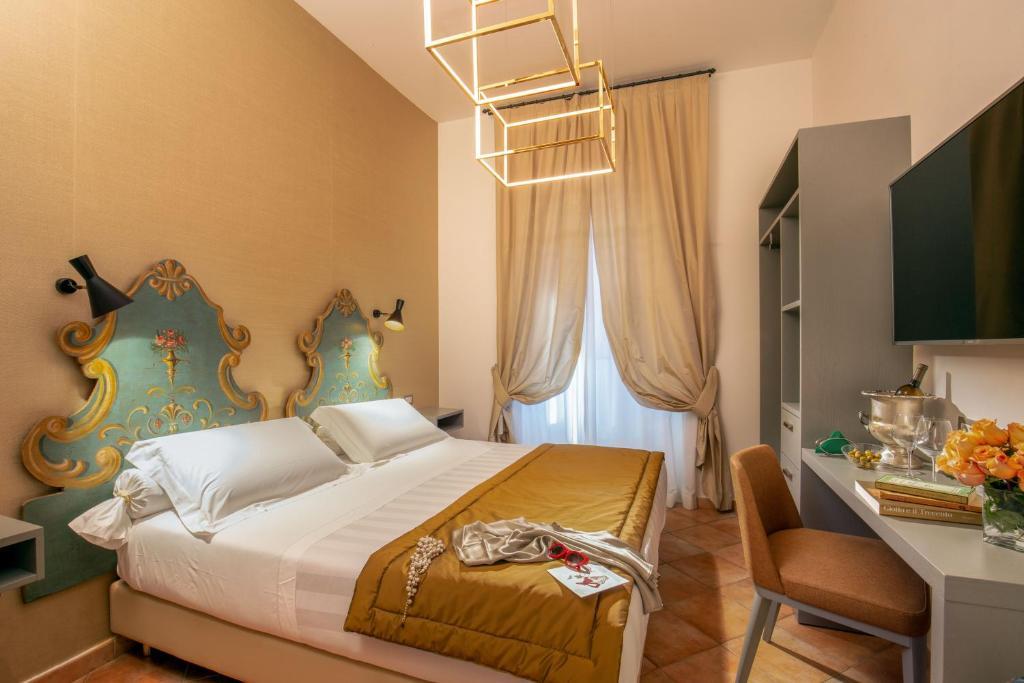 Кровать или кровати в номере Hotel Mozart