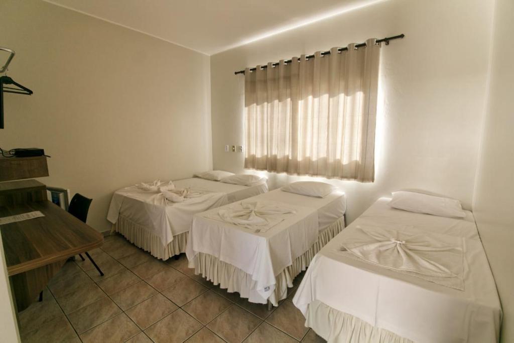 Cama ou camas em um quarto em Hotel Serra Geral