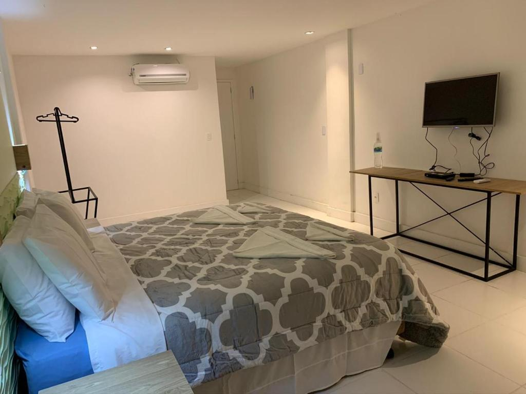 A bed or beds in a room at Clube Náutico Ibiza