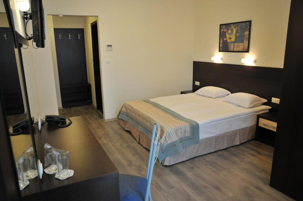 A bed or beds in a room at Hotel Burgas Free University