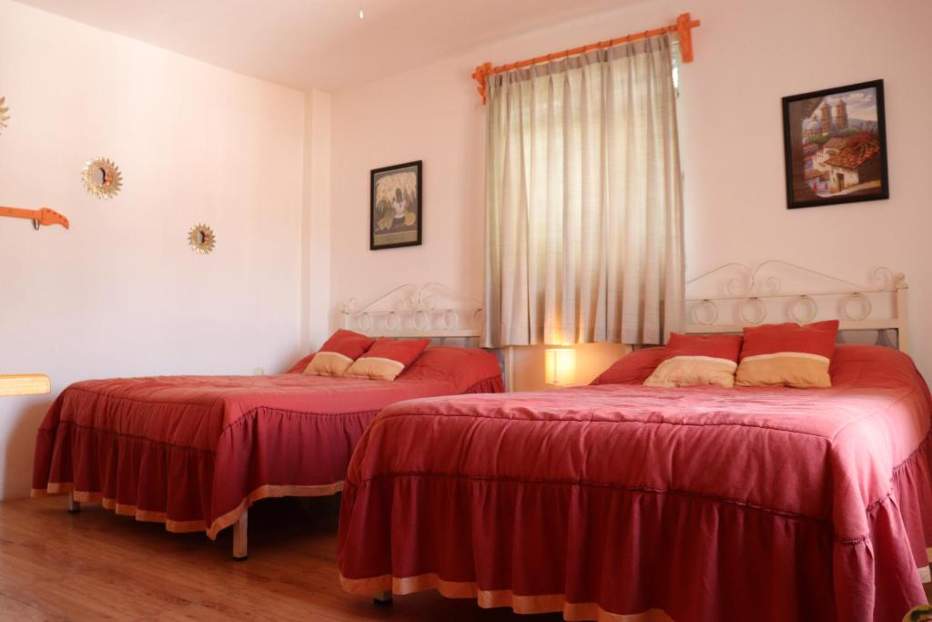 A bed or beds in a room at Casa Frida Hotel y Spa by Rotamundos