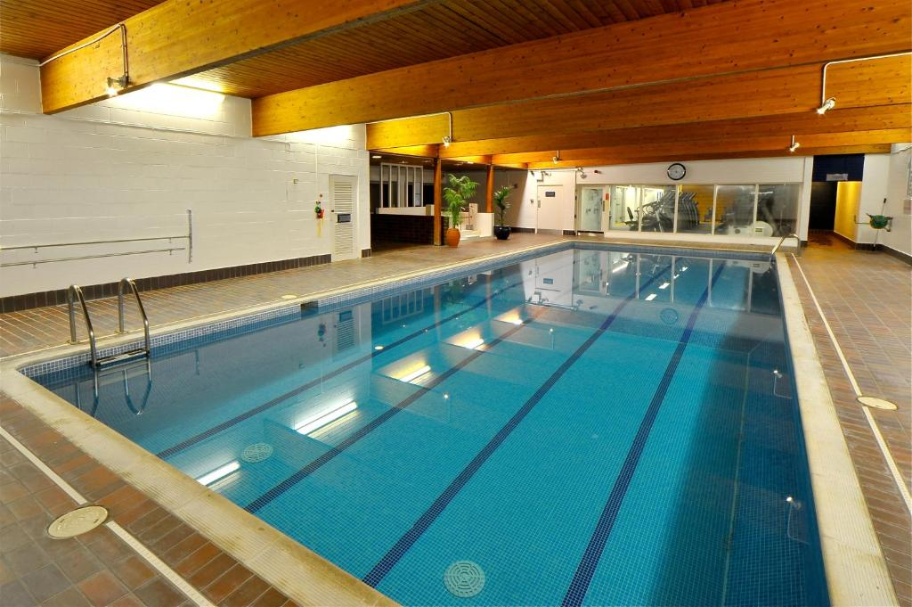 The swimming pool at or close to Eight Acres Hotel & Spa