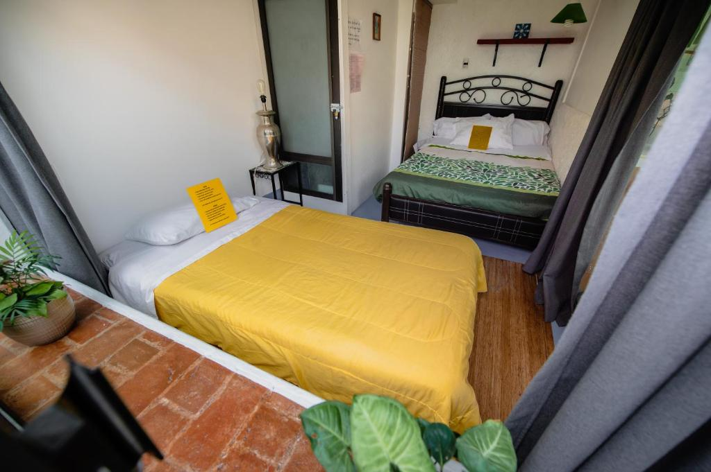 A bed or beds in a room at Hostel Mexico DF Airport