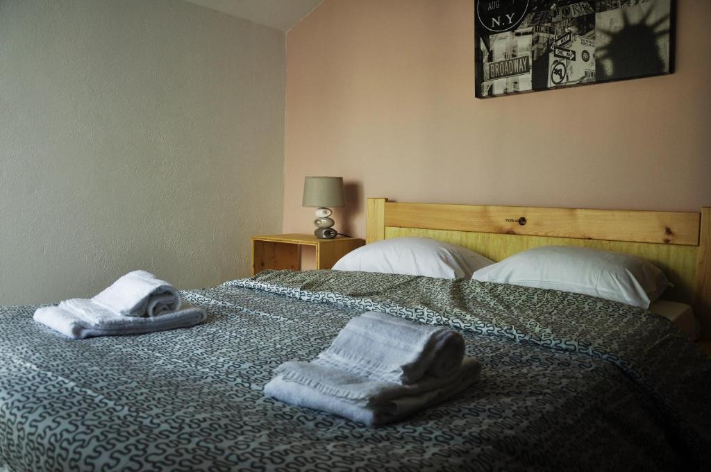 Ein Bett oder Betten in einem Zimmer der Unterkunft Hostel 33