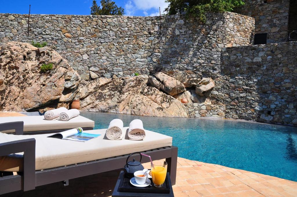 The swimming pool at or near Hôtel Case Latine