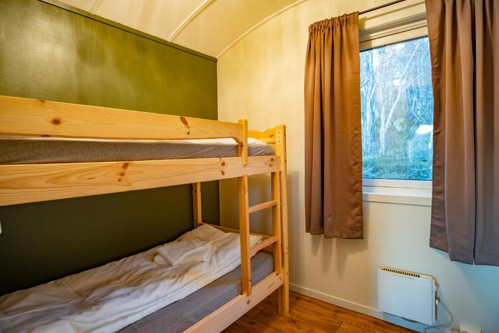 A bunk bed or bunk beds in a room at Skagi Senja hotel & lodge