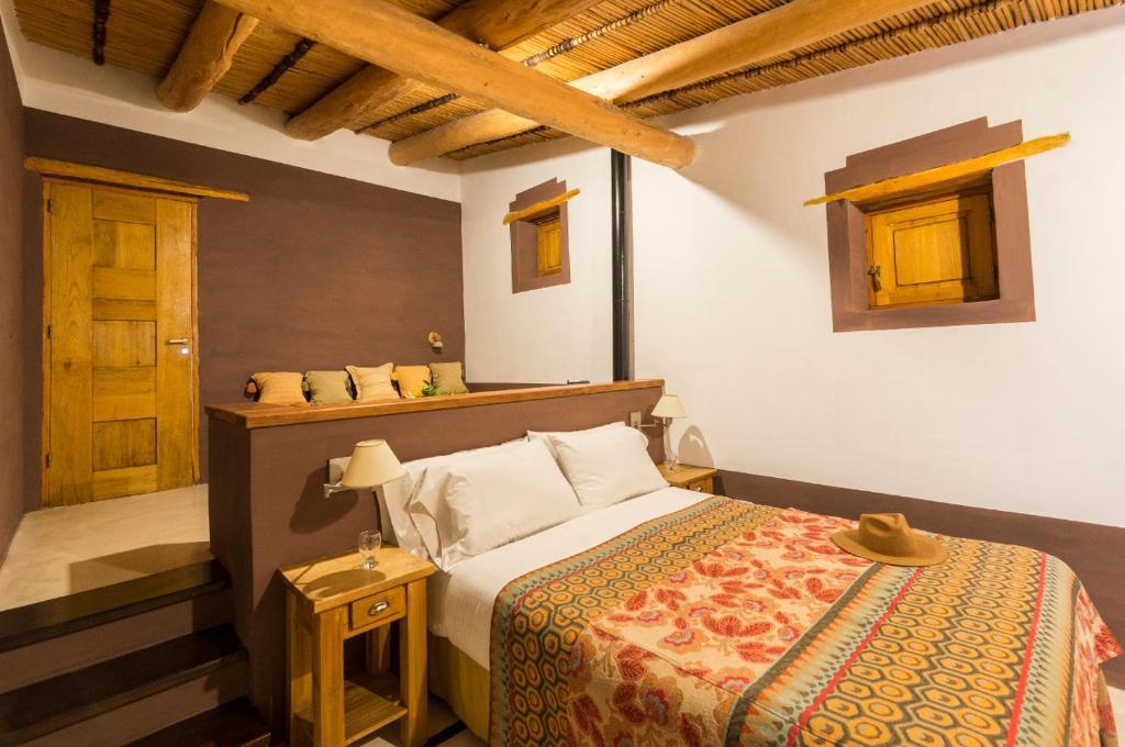 Una cama o camas en una habitación de Posada de Luz