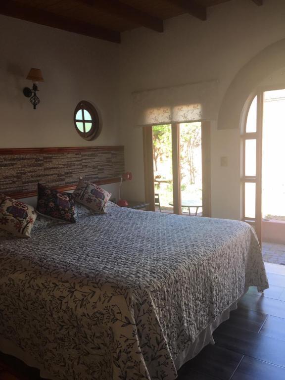 Cama ou camas em um quarto em Hotel Puritama