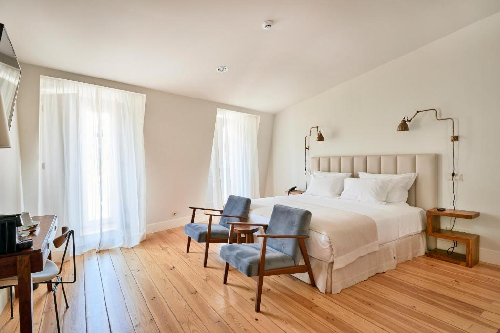 A bed or beds in a room at Alegria A Lisbon Boutique Hotel