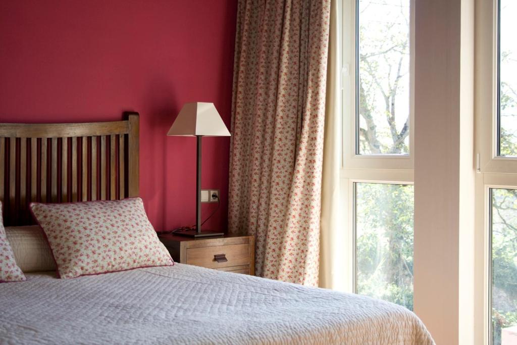 Cama o camas de una habitación en Las Casas Rurales Huerta San Benito