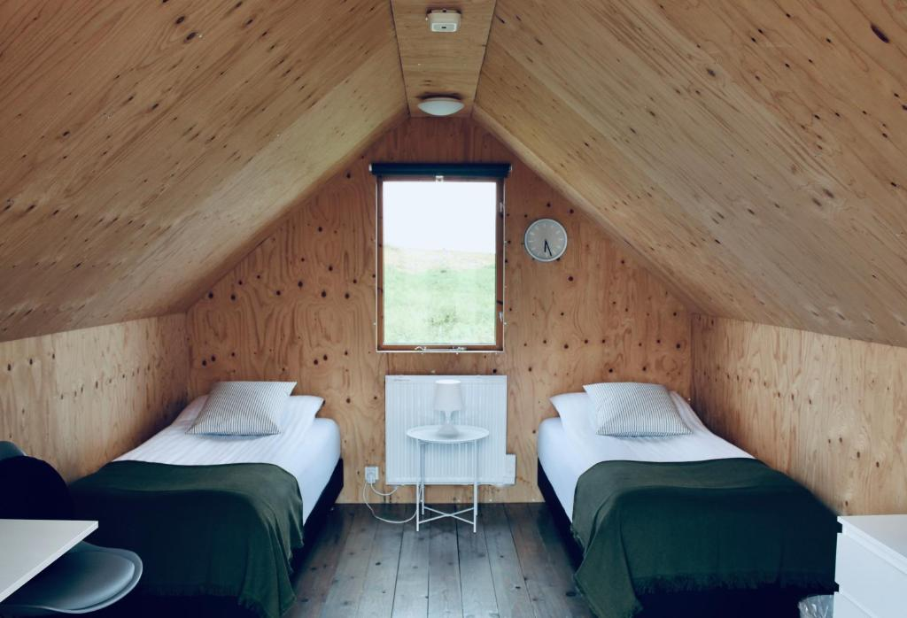 A bed or beds in a room at iStay Cottages