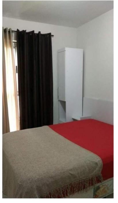 A bed or beds in a room at Apartamento
