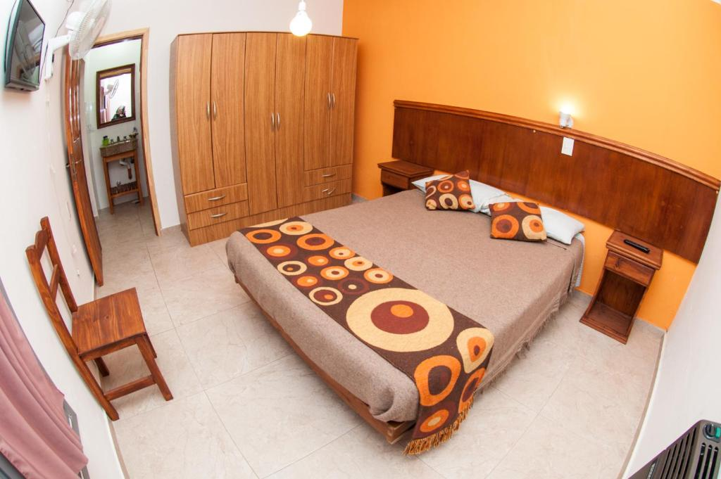 A bed or beds in a room at DYD Hotel