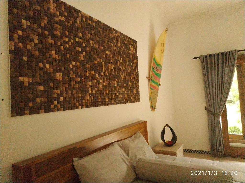 A bed or beds in a room at Harris surf villa