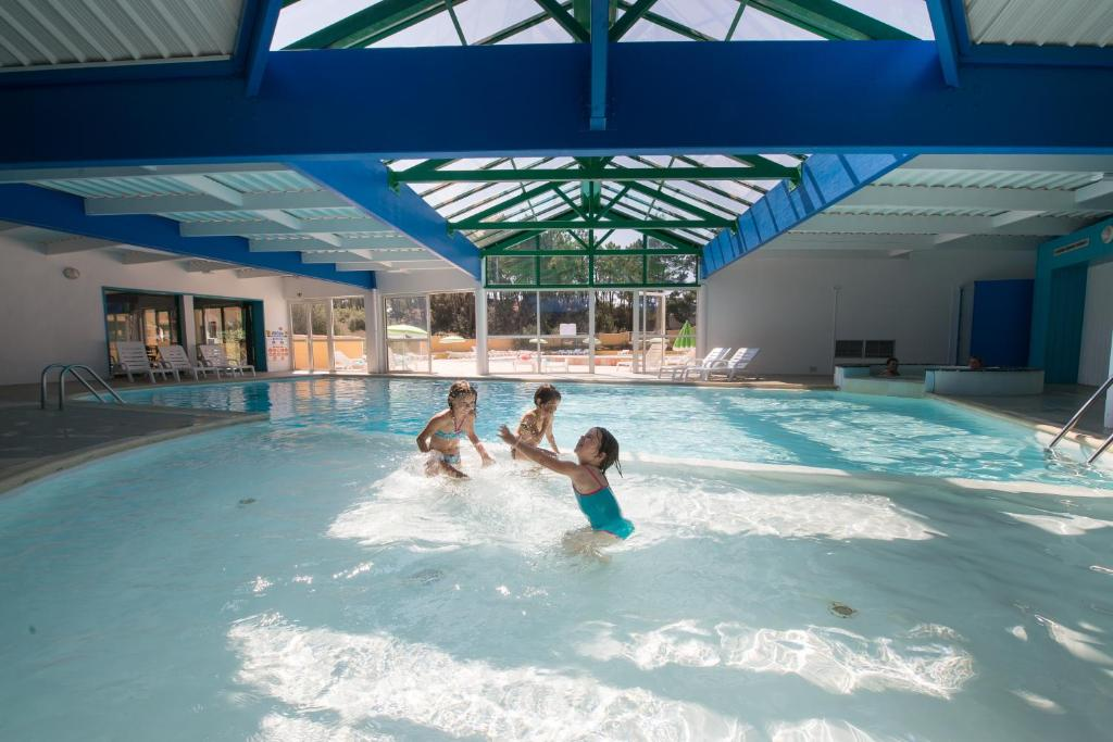 The swimming pool at or near Le Domaine des Pins