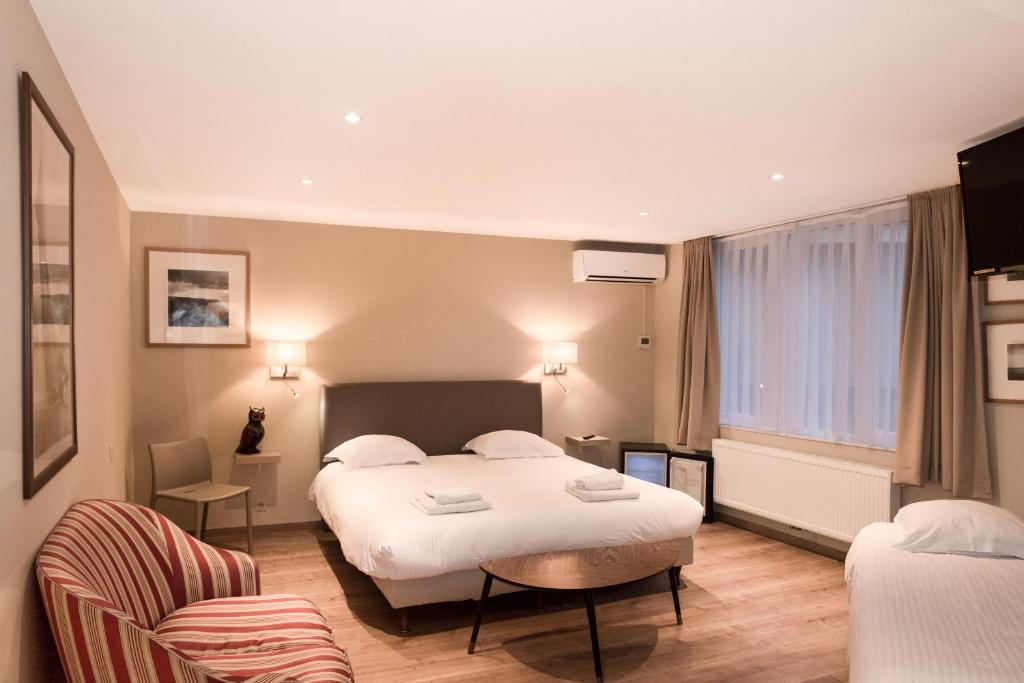 A bed or beds in a room at Hotel Noga