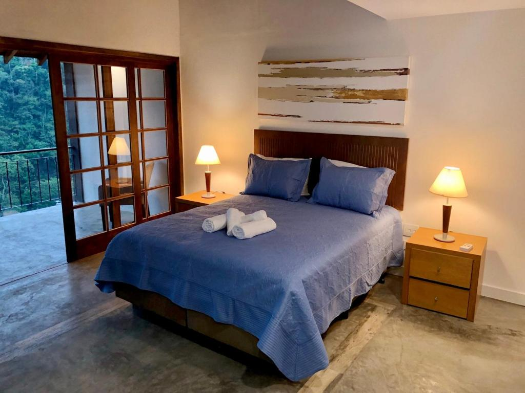 A bed or beds in a room at Pousada Golf Village