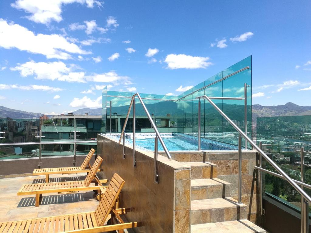 A view of the pool at Café Hotel Medellín or nearby