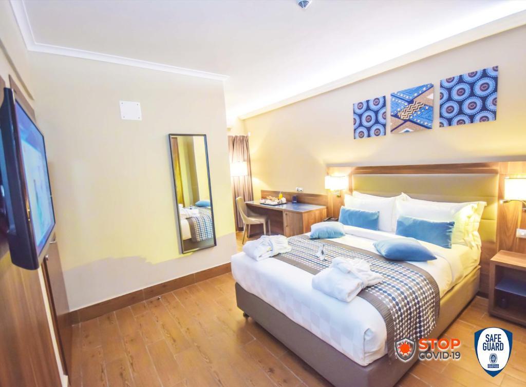 Un ou plusieurs lits dans un hébergement de l'établissement Hotel La Falaise Bonapriso