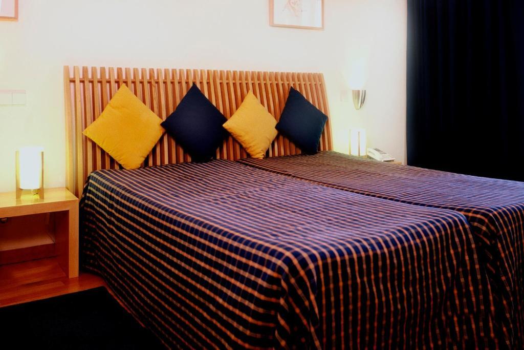 Кровать или кровати в номере Hotel Paulo VI