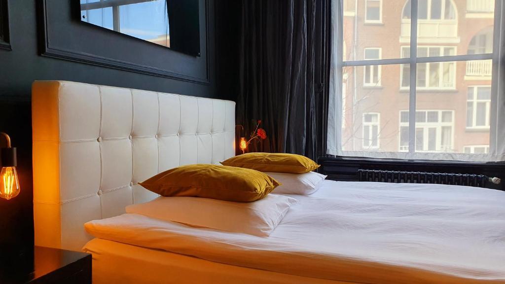 Een bed of bedden in een kamer bij Residenz Stadslogement