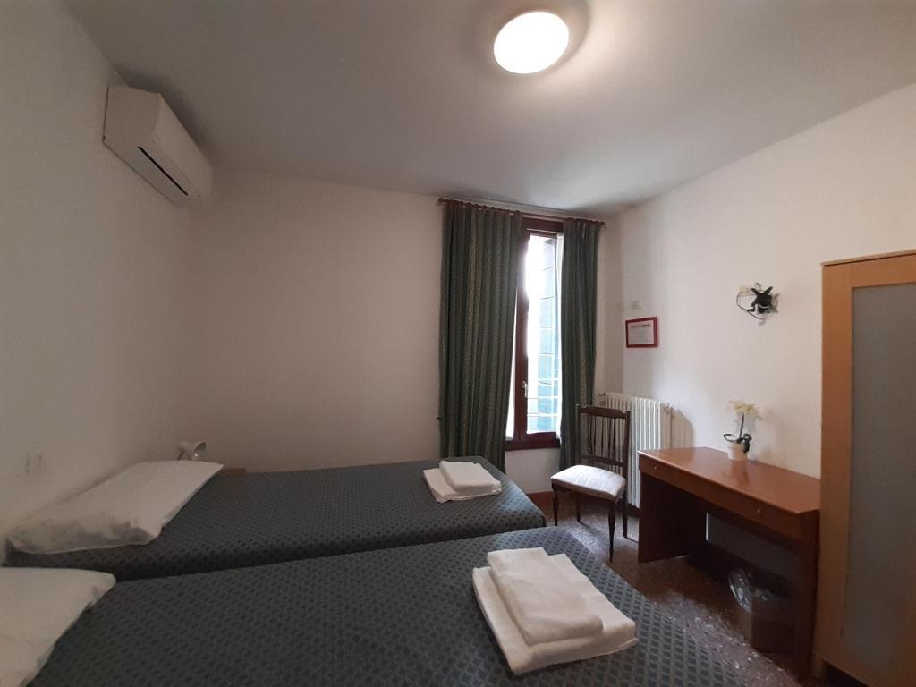 Un ou plusieurs lits dans un hébergement de l'établissement Foresteria Valdese Venezia
