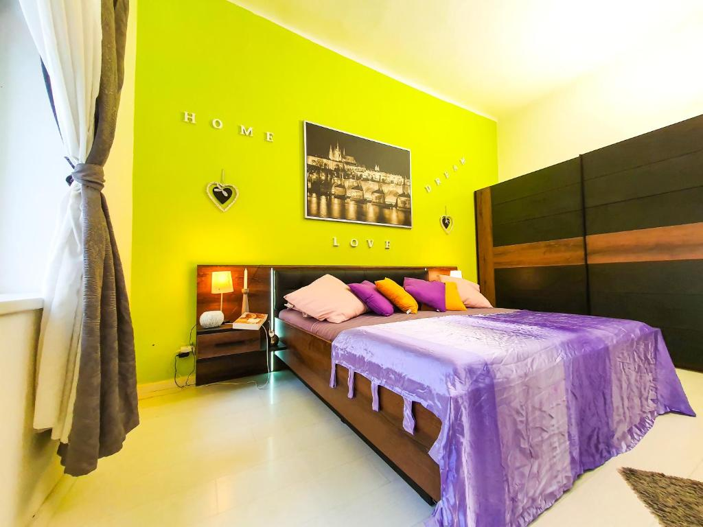 A bed or beds in a room at Rent Apartment Prague Centre