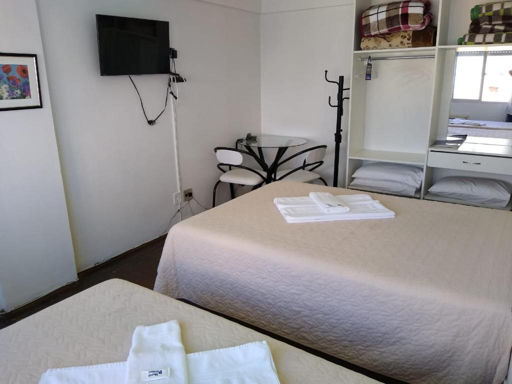 A bed or beds in a room at Hotel Paraiso