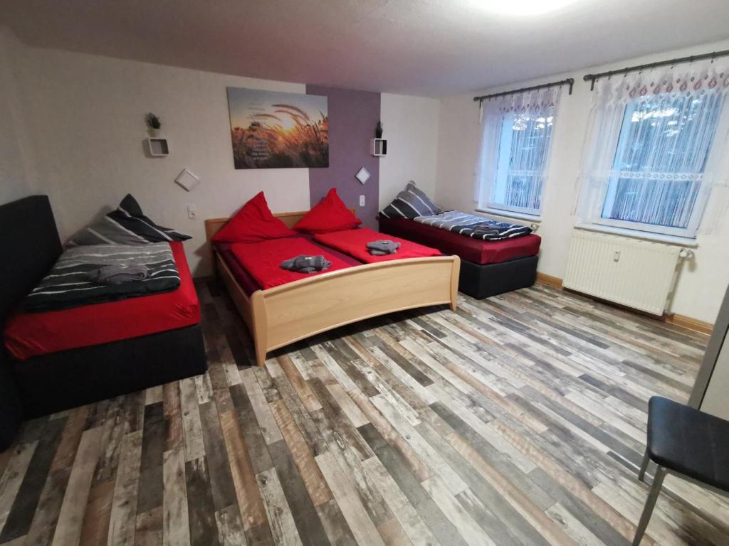 Ein Bett oder Betten in einem Zimmer der Unterkunft Vor den Toren Dresdens