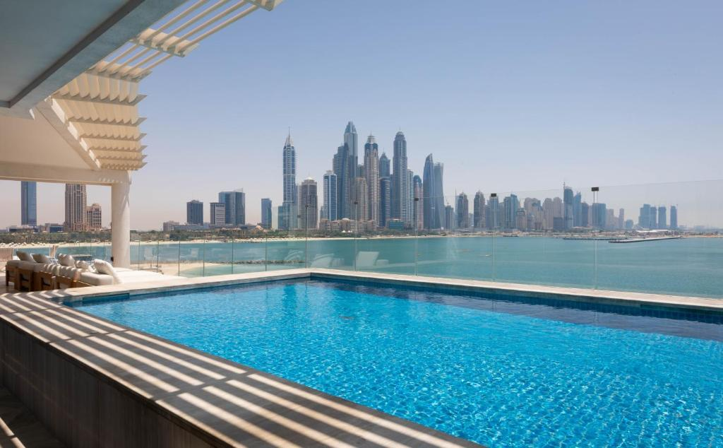 The swimming pool at or near Eden Dubai - FIVE Residences