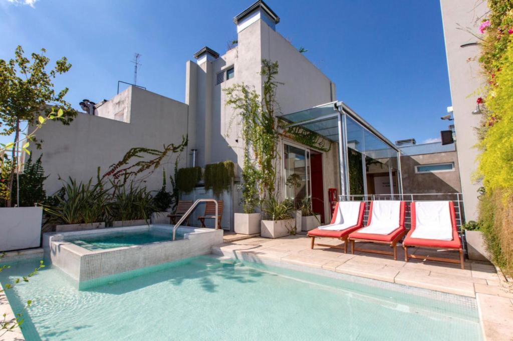A piscina localizada em Palo Santo Hotel ou nos arredores