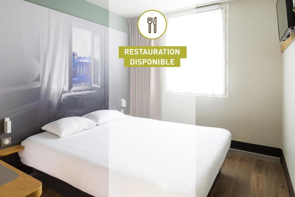 Un ou plusieurs lits dans un hébergement de l'établissement B&B Hôtel Saint-Malo Centre