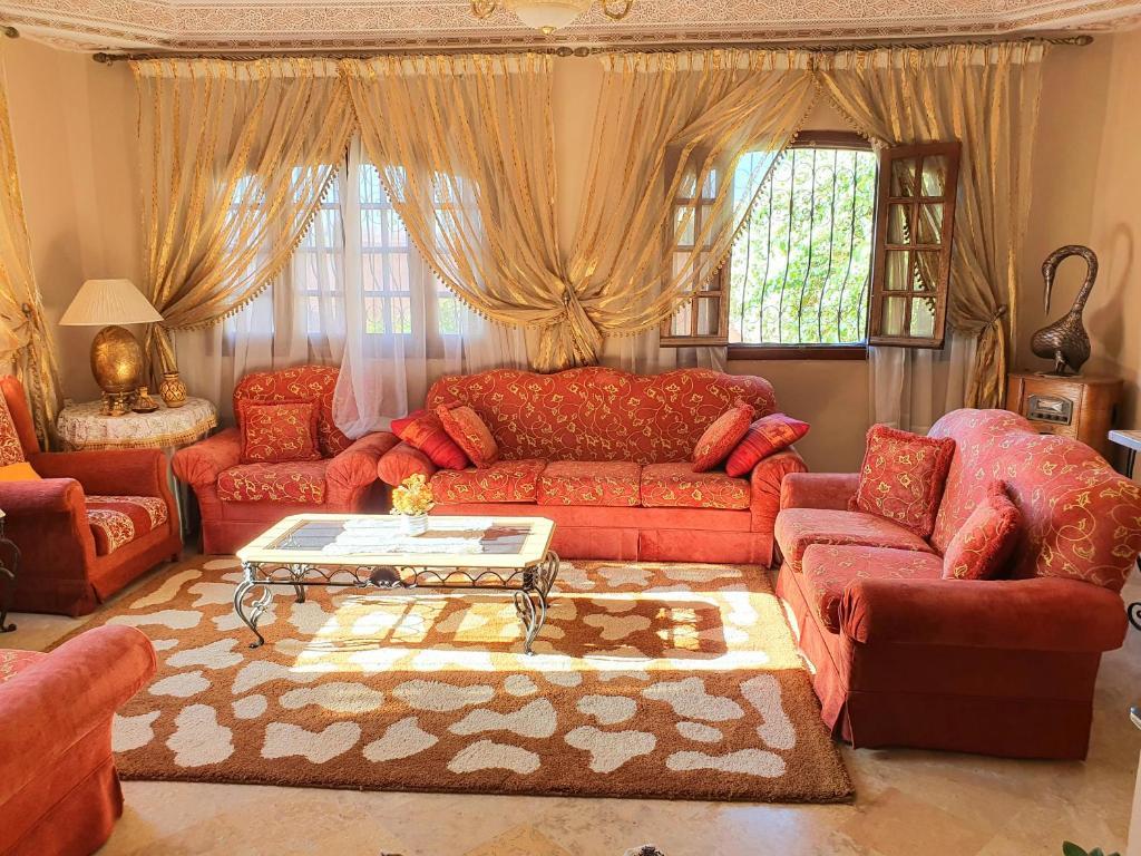 A seating area at Oranger Marrakech