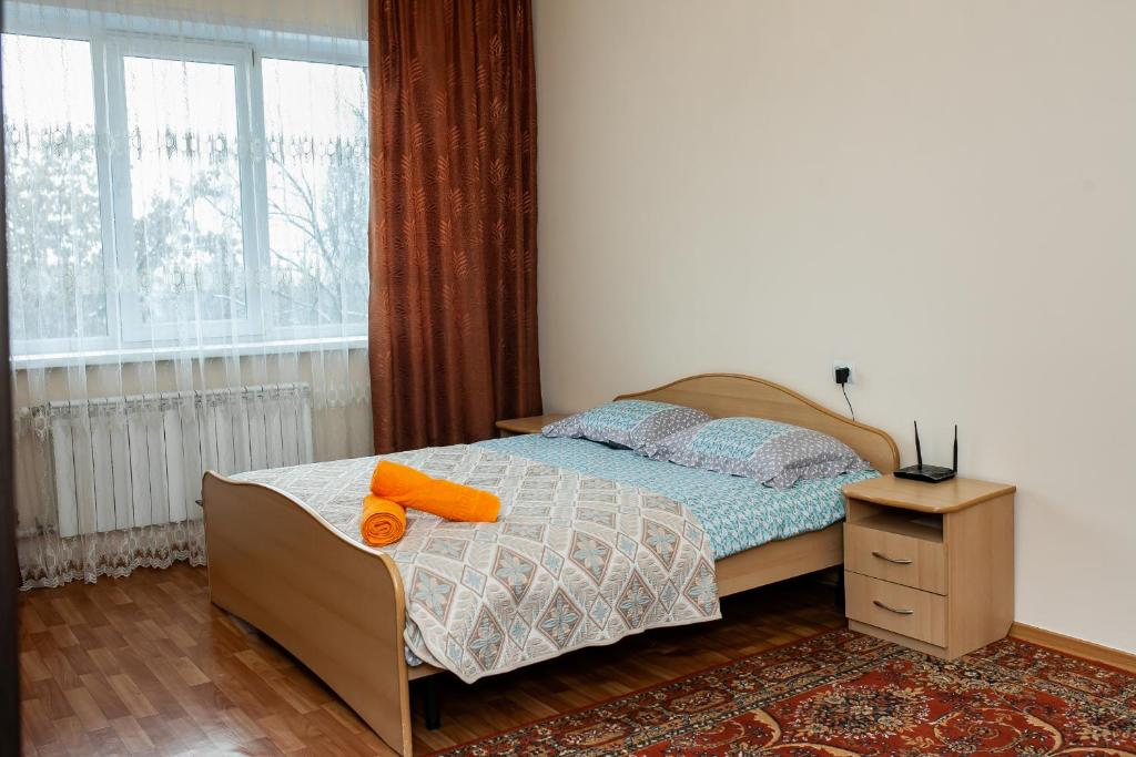 A bed or beds in a room at YourHouse Микрорайон Аксай-1, дом 17