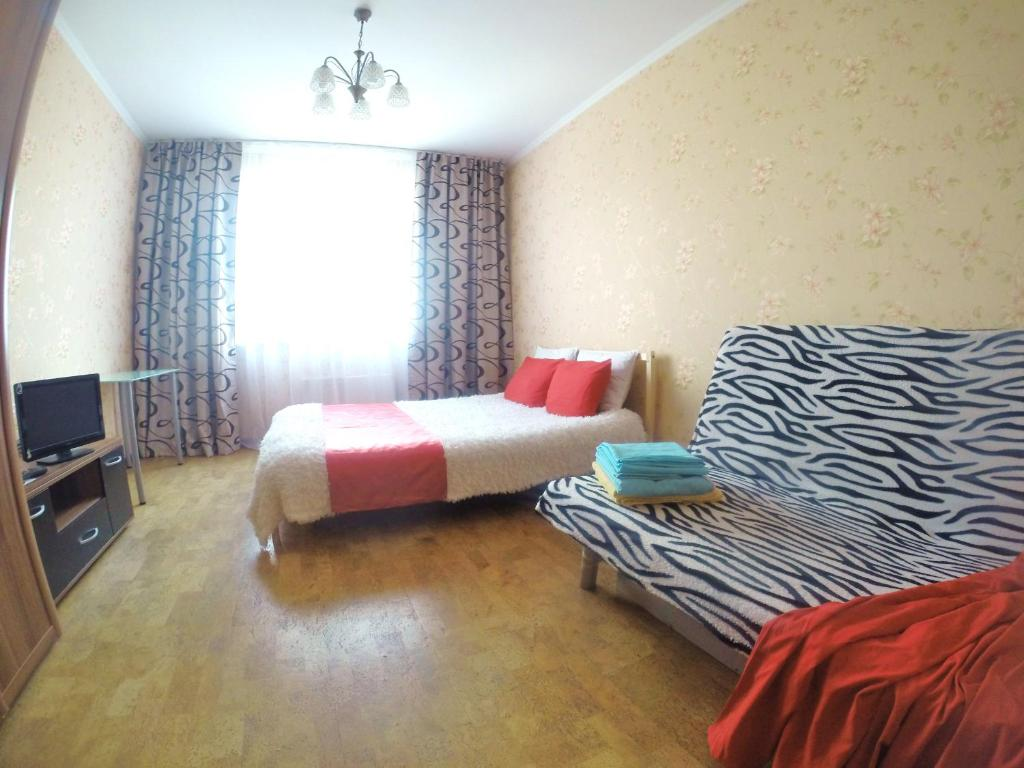 A bed or beds in a room at Апартаменты на Белореченской, 6