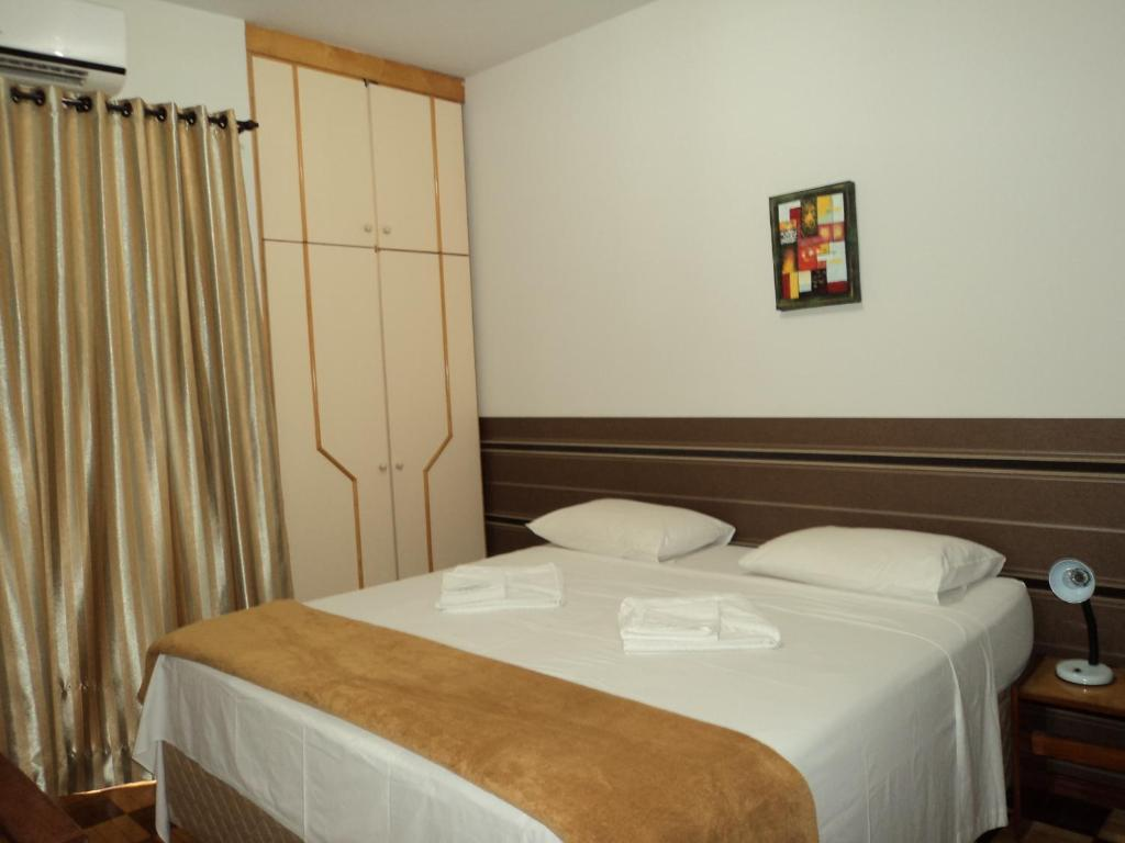 A bed or beds in a room at Iguassu Central Bed & Breakfast