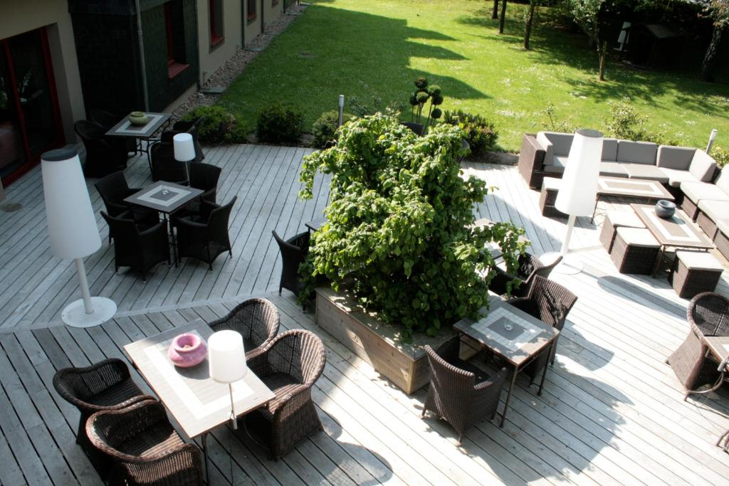 A patio or other outdoor area at Hôtel Antares & Spa