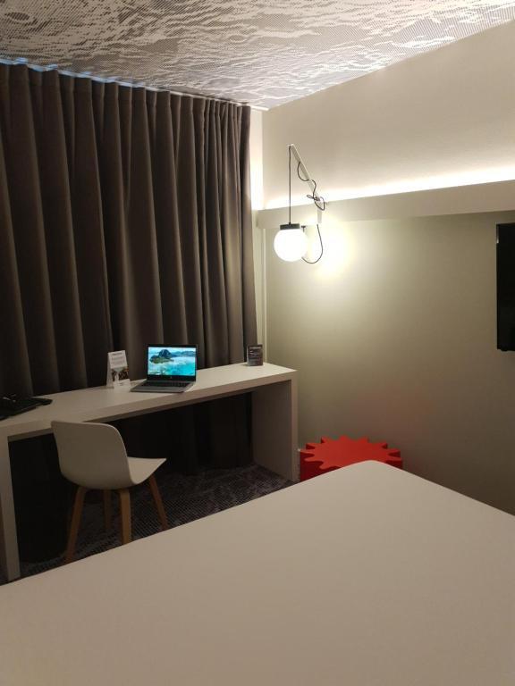 Ein Bett oder Betten in einem Zimmer der Unterkunft ibis Luxembourg Aeroport