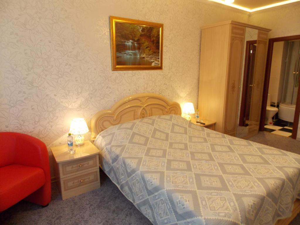 Кровать или кровати в номере Troyka