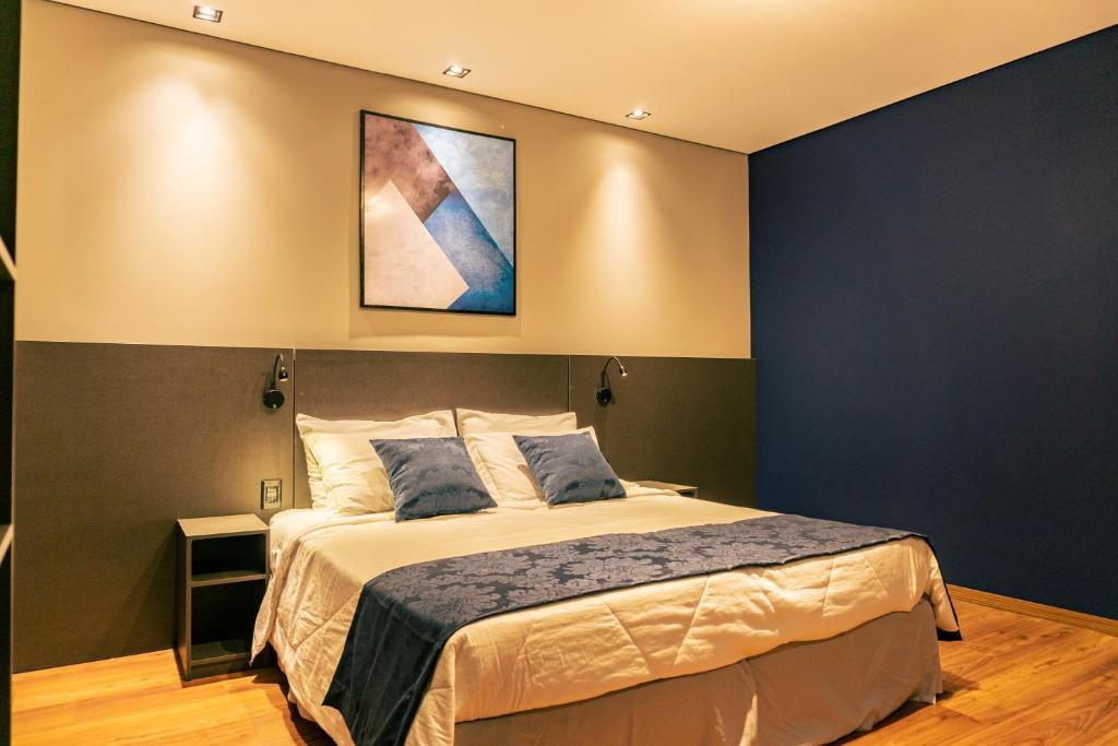 Cama ou camas em um quarto em Mayná Palace Hotel