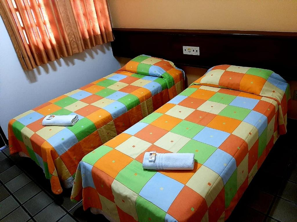 A bed or beds in a room at DUNNAS PARK HOTEL